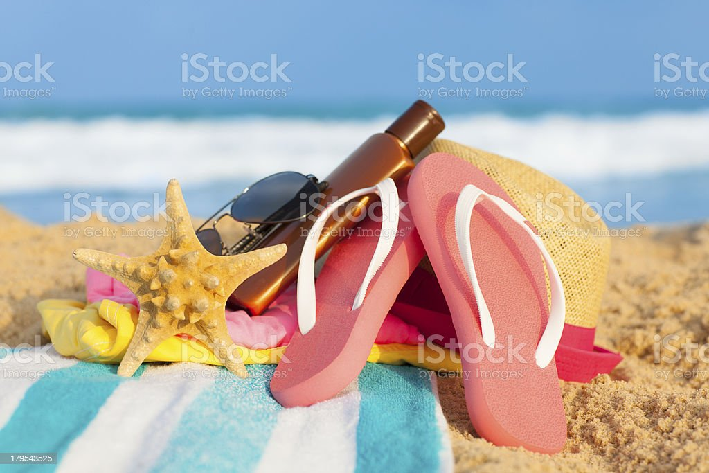 Beach accessories on blue background. royalty-free stock photo