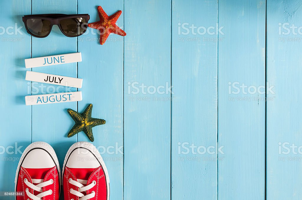 Beach accessories on blue wooden board. Summer travel concept stock photo