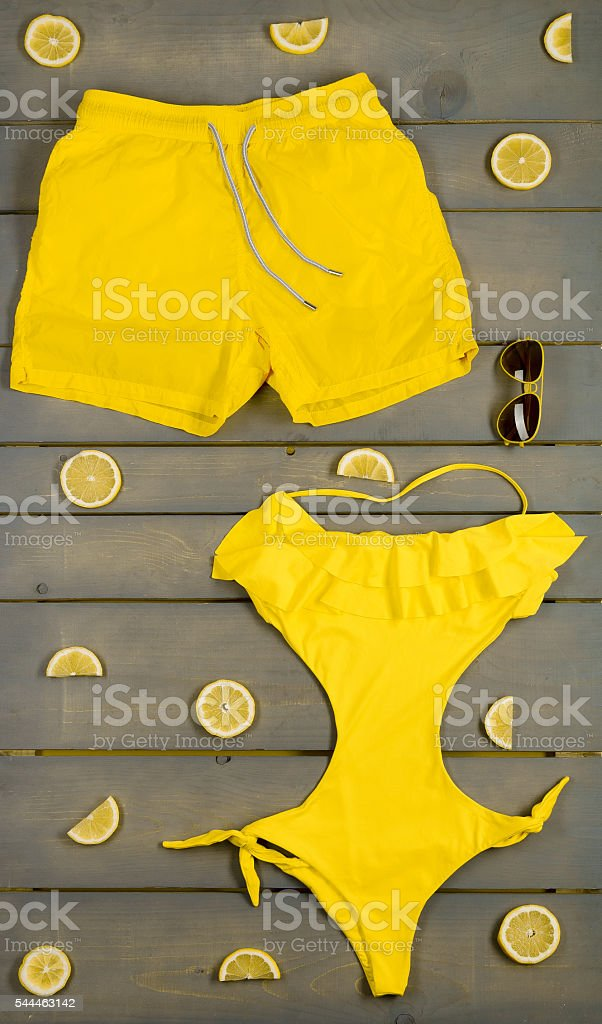 Beach accessories on wooden background. stock photo