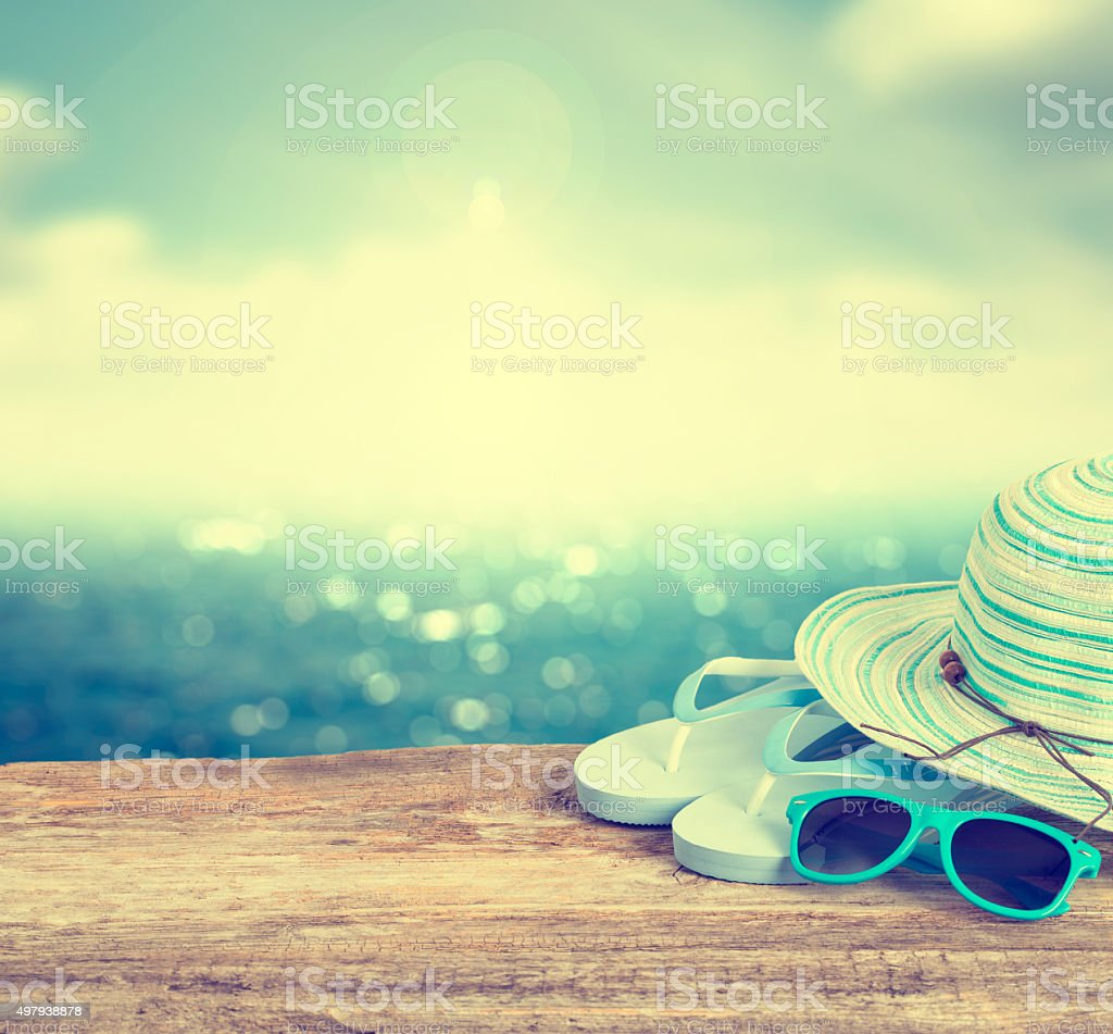 Beach accessories on wooden board. stock photo