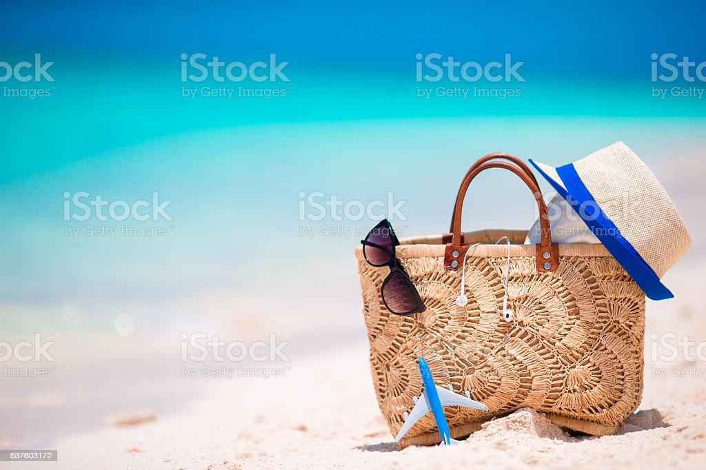 Beach accessories - straw bag, headphones, toy plane and sunglasses stock photo