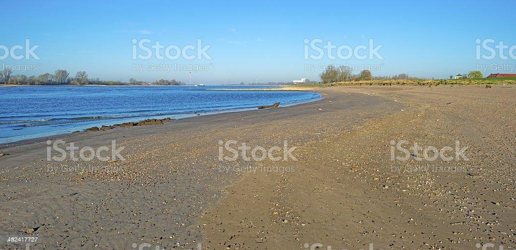 Beach along a sunny river stock photo