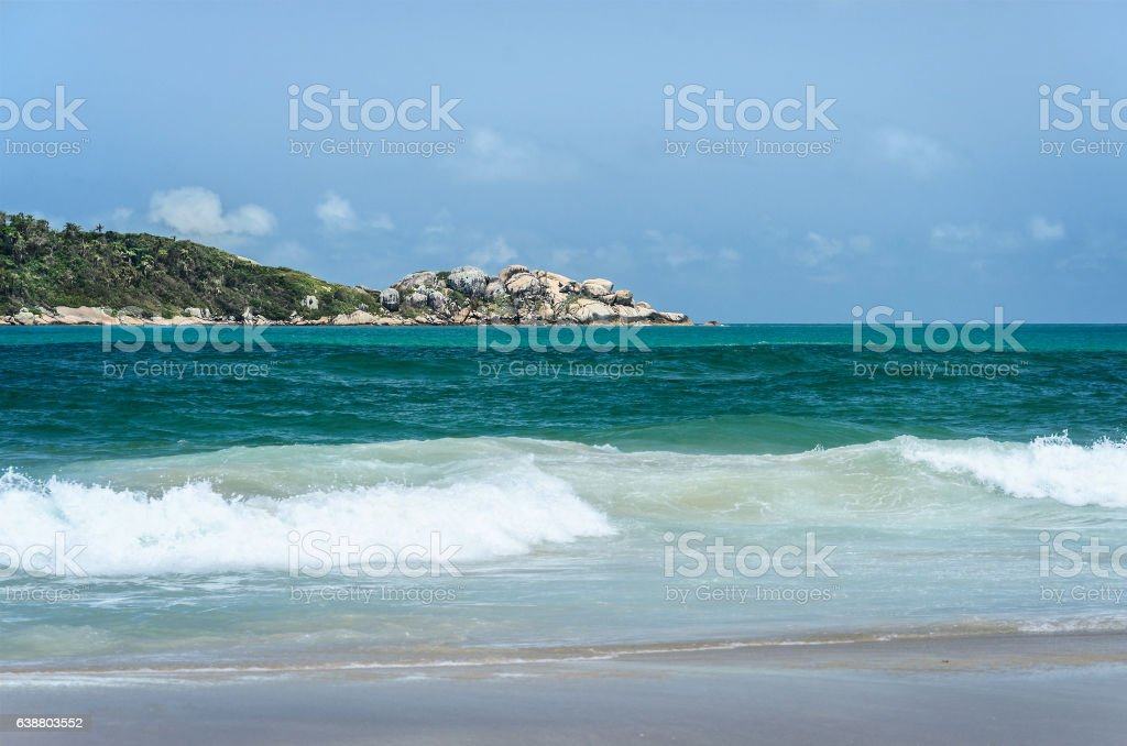 Beach and an island in the background stock photo