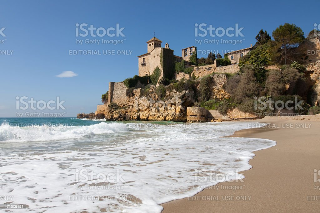 Beach and castle of Tamarit stock photo