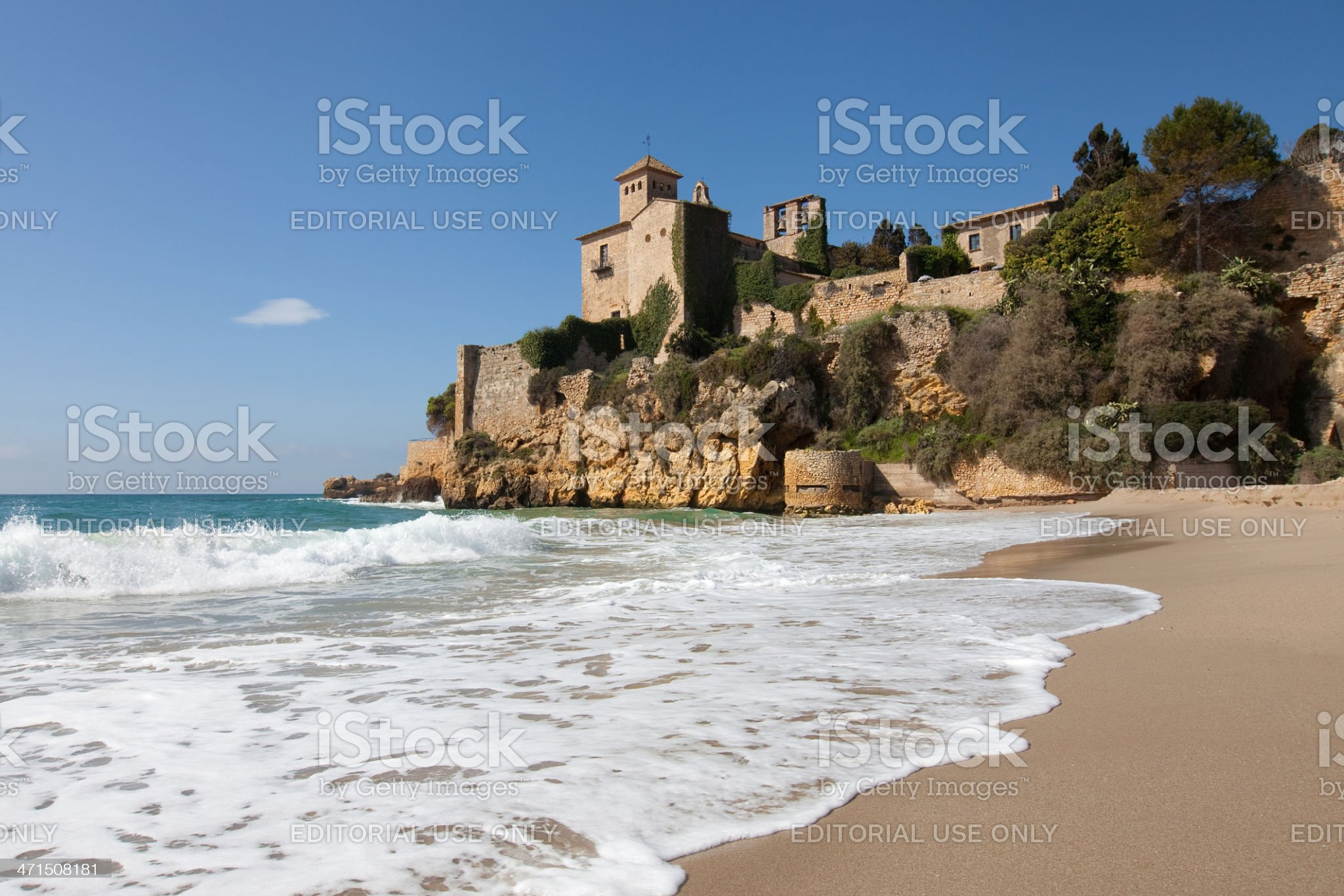 Beach and castle of Tamarit royalty-free stock photo
