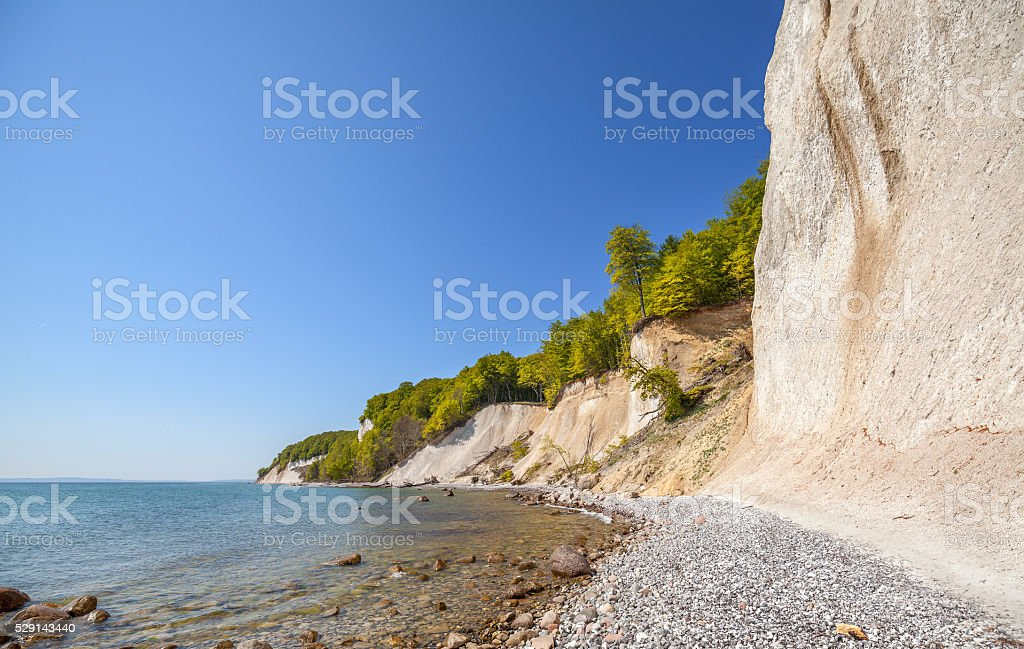 Beach and chalk cliffs on the Rugen Island, Germany. stock photo