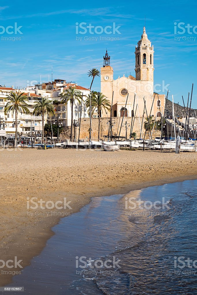 Beach and church in Sitges stock photo