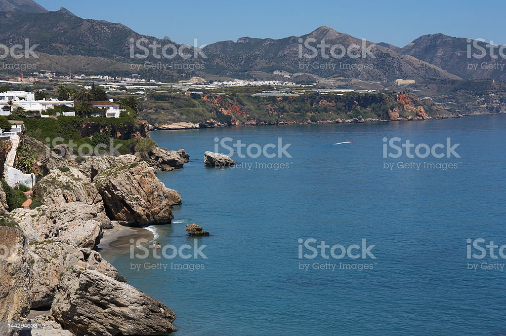 Beach and coast in Nerja, Spain stock photo
