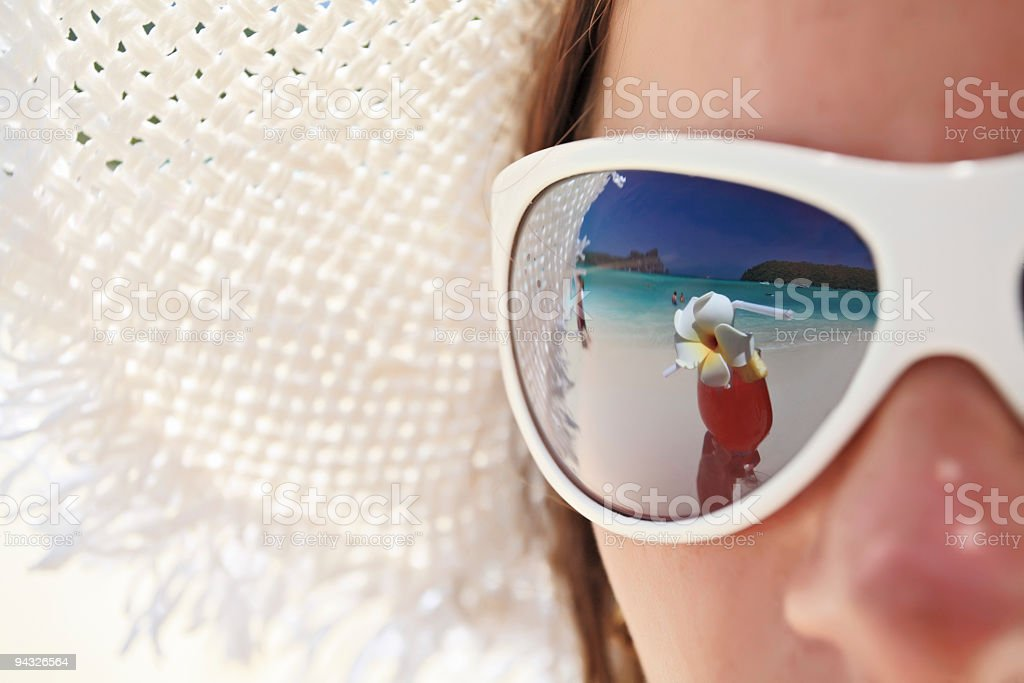 Beach and cocktail in girl's sunglass. royalty-free stock photo