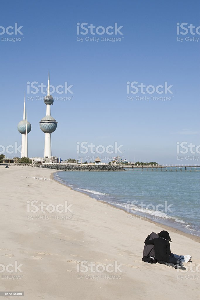 Beach and Kuwait Towers stock photo