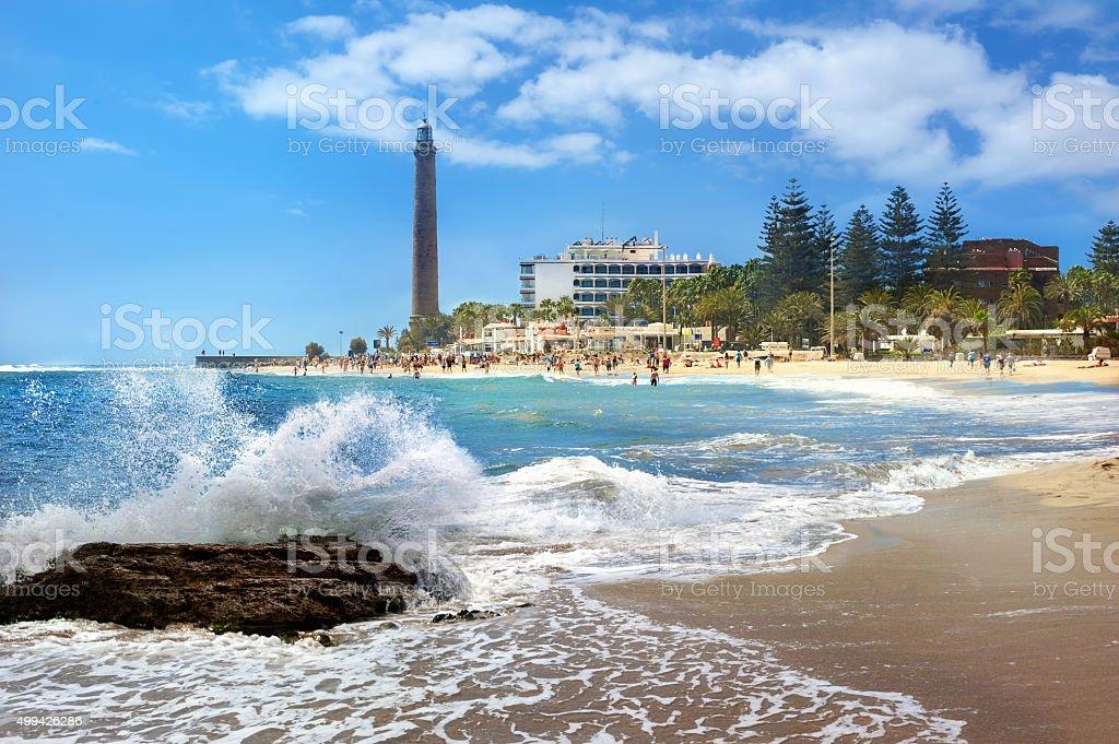 Beach and lighthouse of Maspalomas. Gran Canaria, Canary Islands stock photo