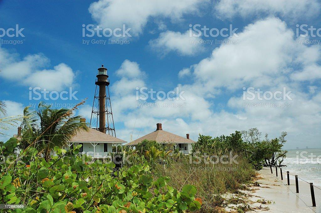 Beach and lighthouse on Sanibel Island, Florida, in the sun stock photo