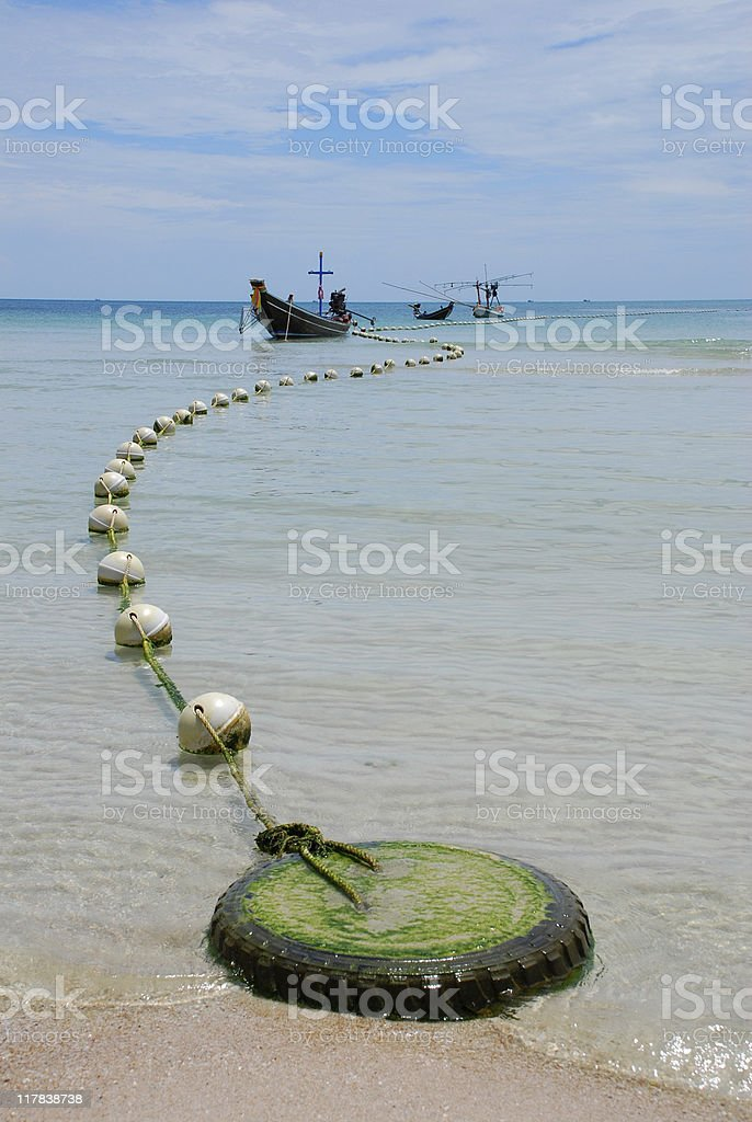 Beach and longtail boats on Ko Phangan, Thailand royalty-free stock photo
