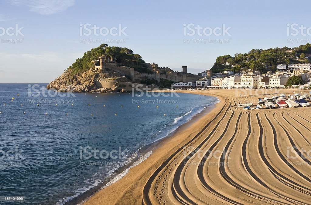 Beach and medieval castle in Tossa de Mar, Spain stock photo