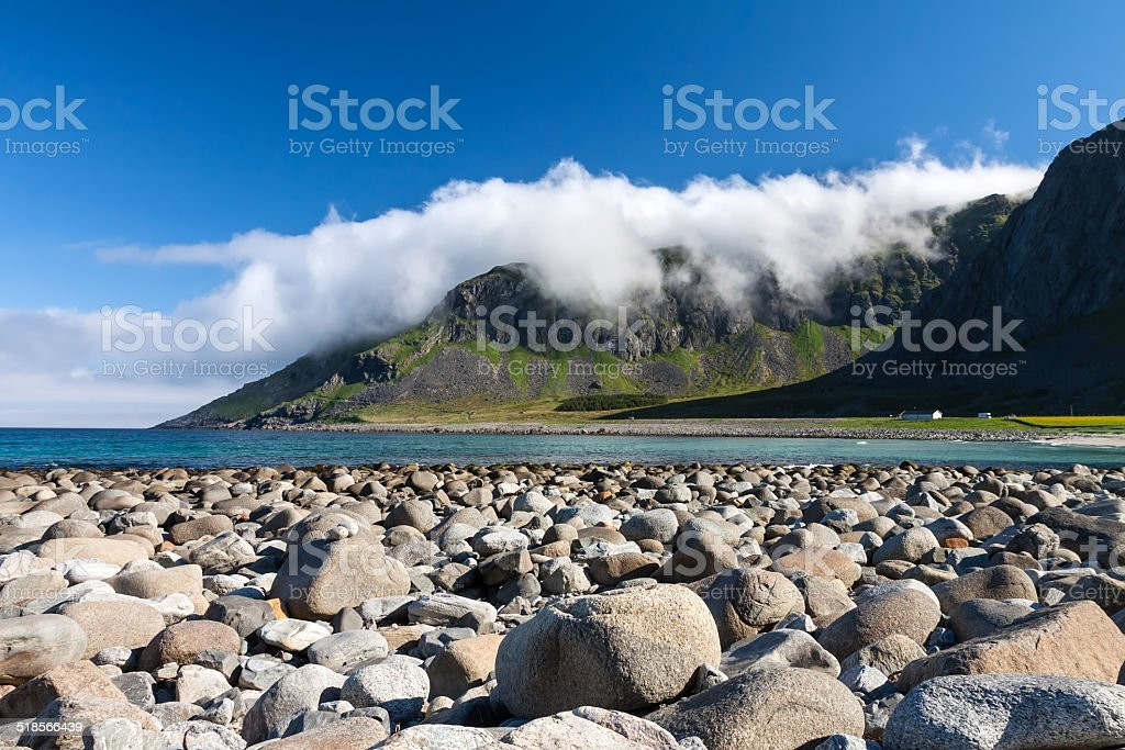 Beach and mountains at Unstad, Lofoten Norway stock photo