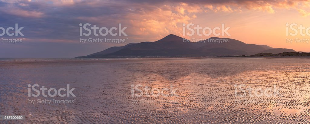 Beach and mountains in Northern Ireland at sunset stock photo