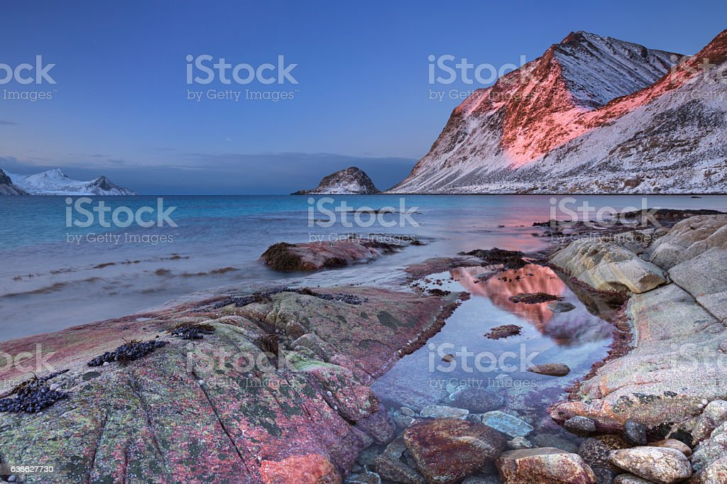 Beach and mountains on the Lofoten in Norway in winter stock photo