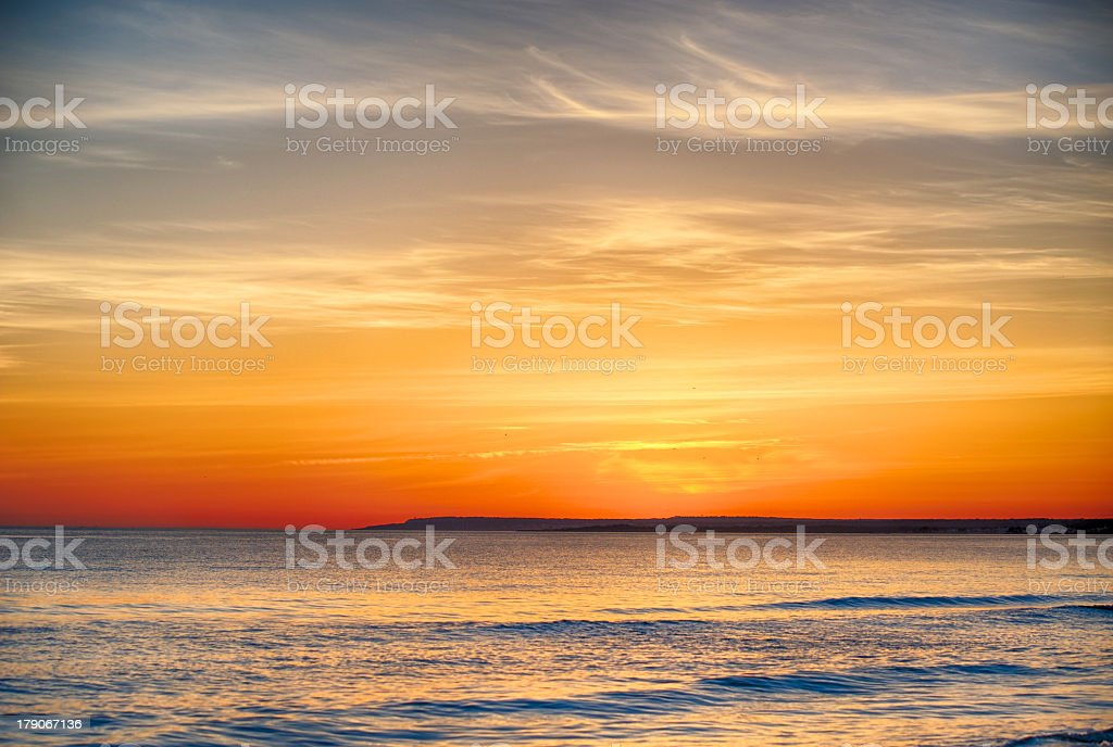 Beach and Ocean during Sunset stock photo