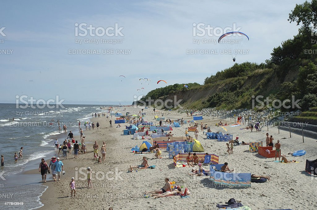 Beach and paragliders stock photo
