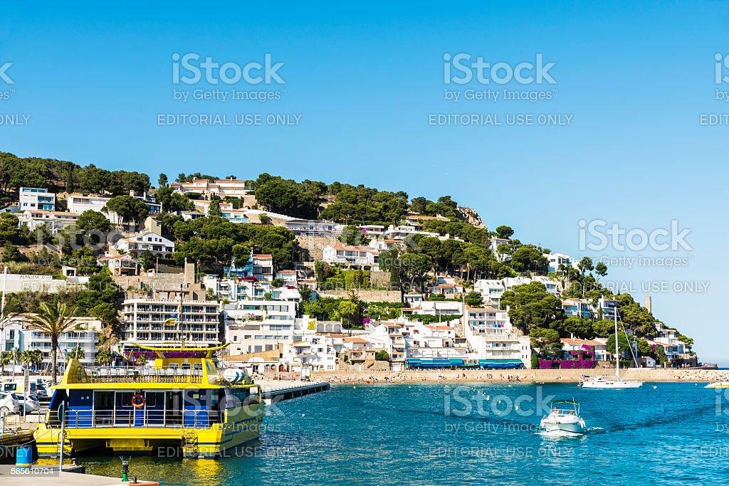 Beach and pier in Estartit, Spain stock photo