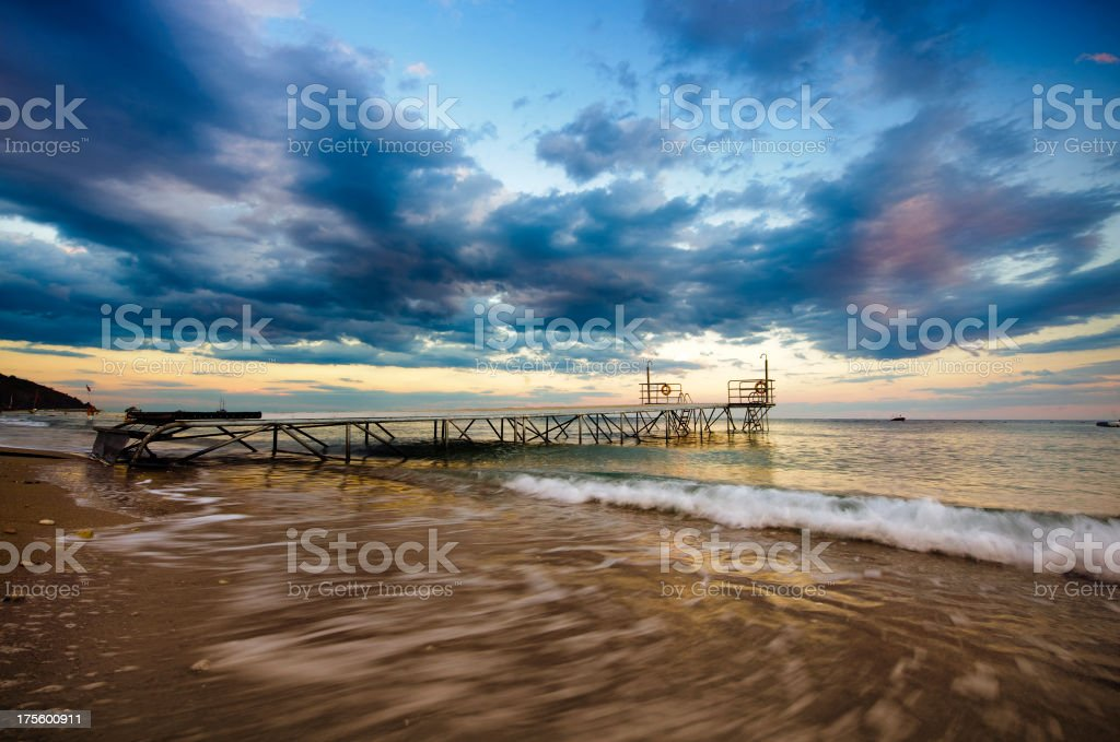 Beach and pier on beautiful sunset stock photo