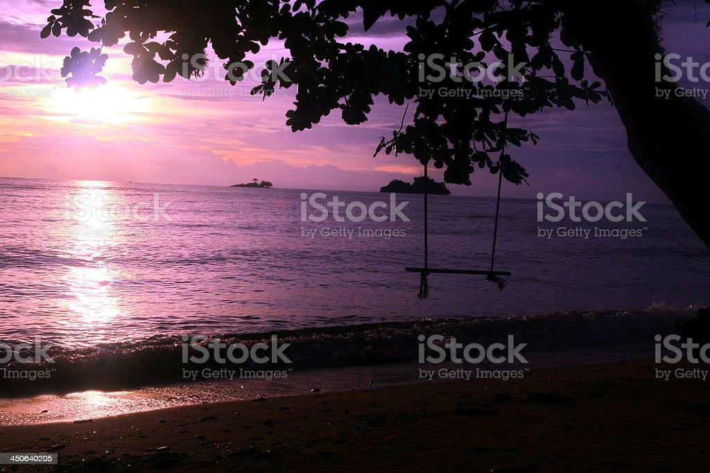 beach and purple sunset sky stock photo