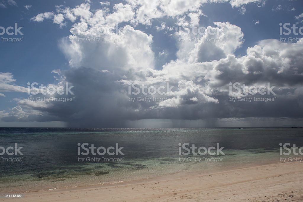 Beach and Rain Clouds stock photo