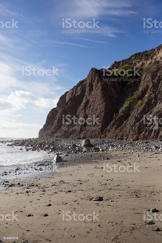 Beach and Rocky Cliff stock photo