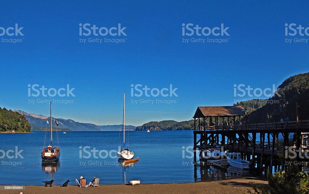 beach and sailboats stock photo