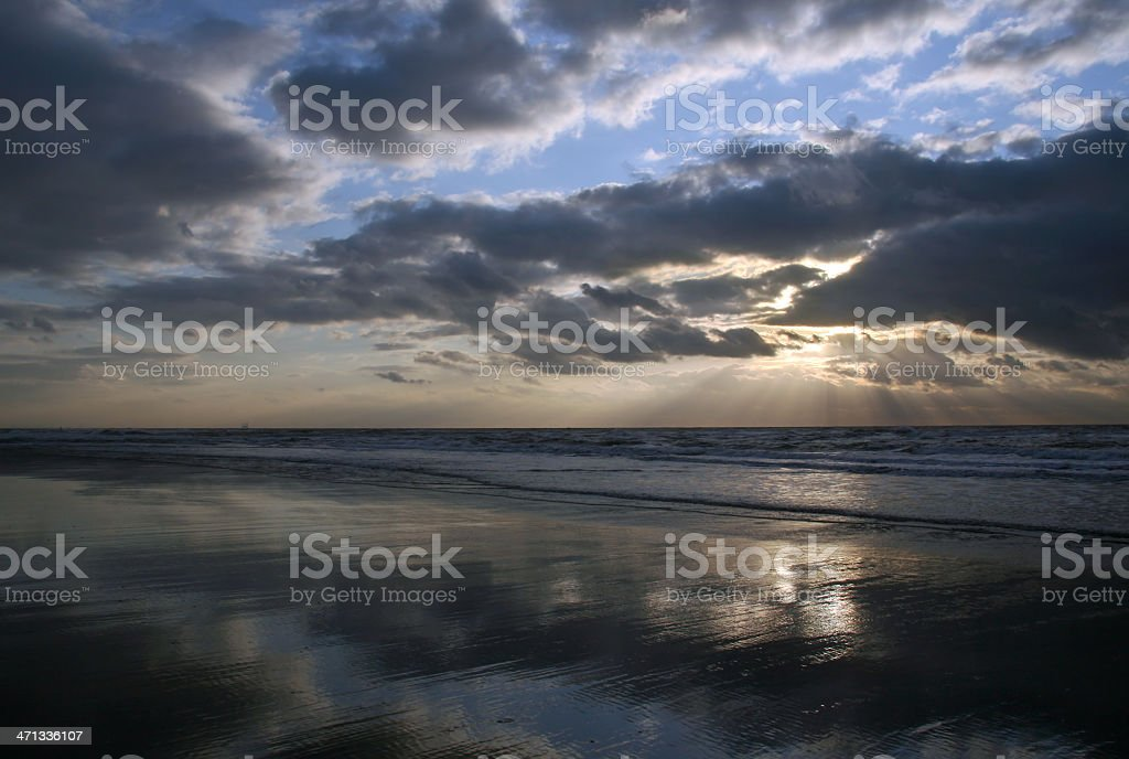 Beach and sea at sunset stock photo