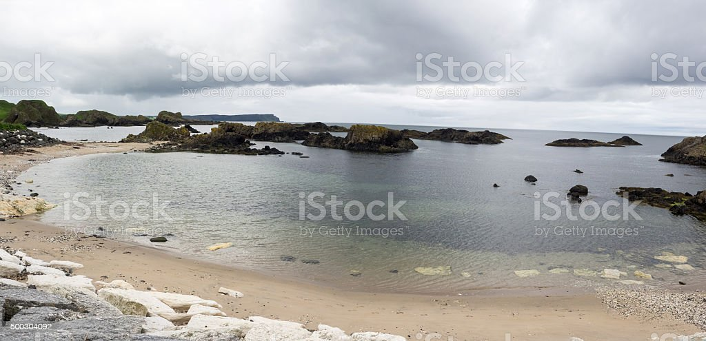 Beach and small bay at Ballintoy stock photo
