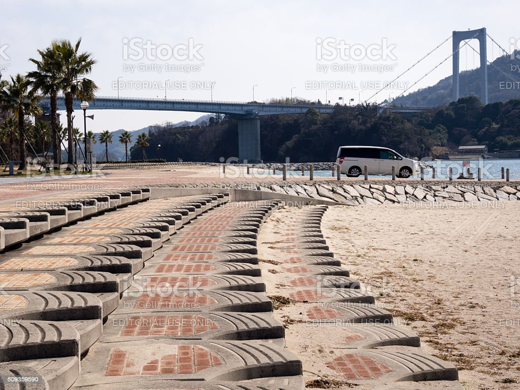 Beach and suspension bridge along Shimanami kaido scenic drive stock photo