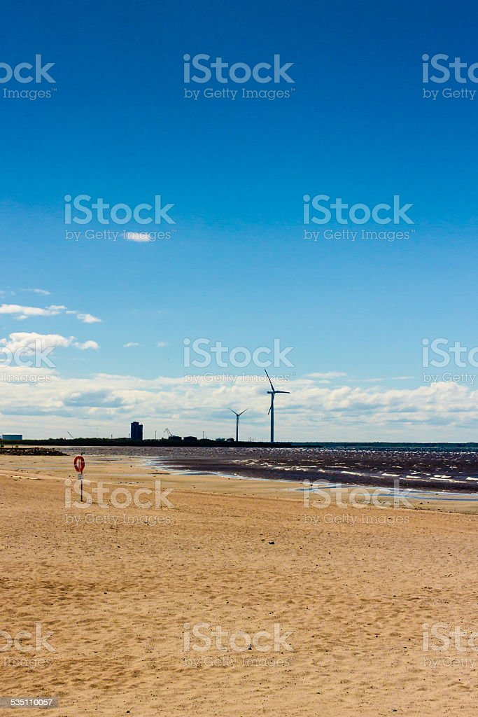 Beach And The Windmills stock photo