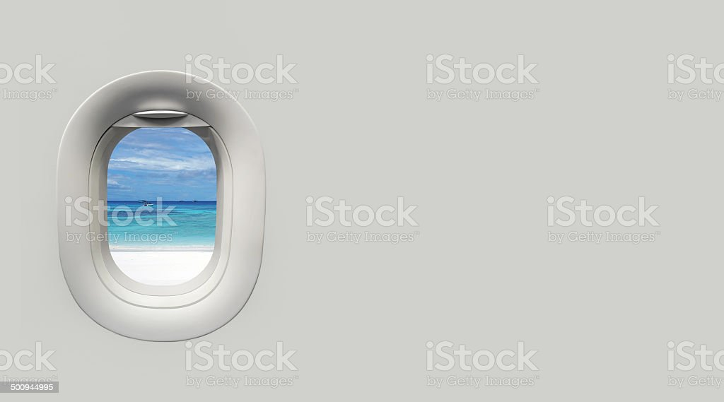 beach and tropical sea at Airplane window and place for text stock photo
