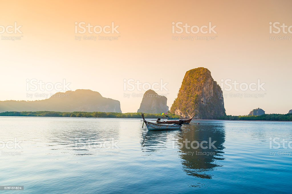 Beach and tropical sea with long-tail boat in thailand stock photo