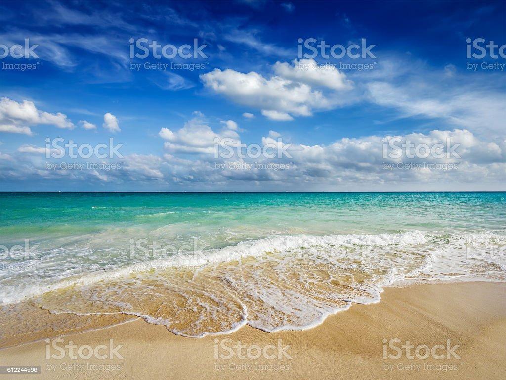 Beach and waves of Caribbean Sea stock photo