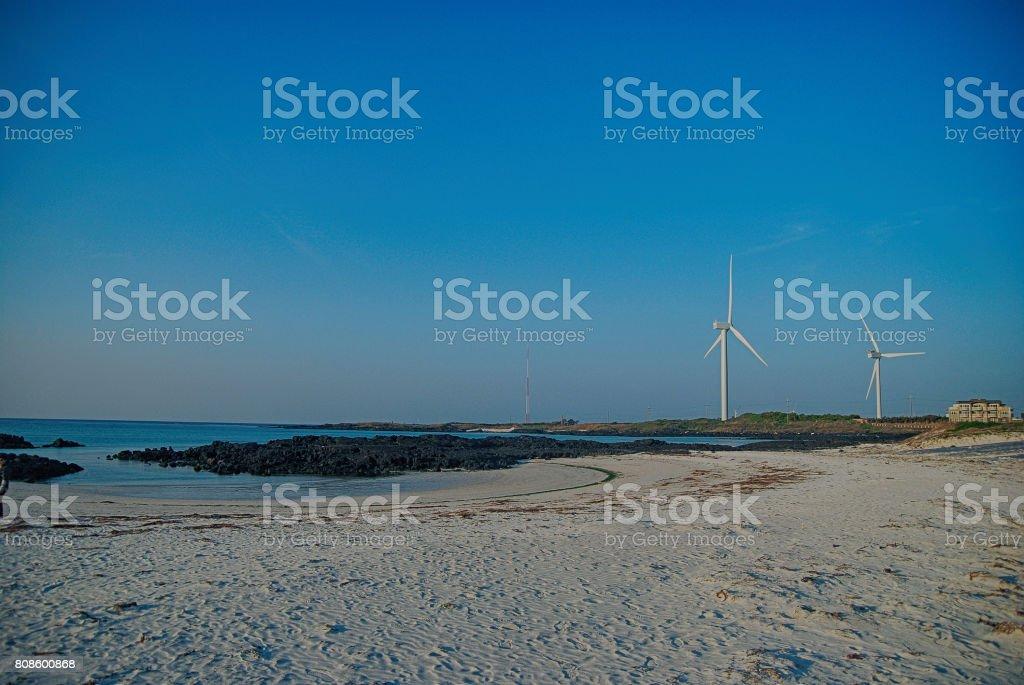 Beach and wind turbines stock photo