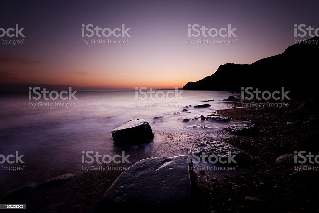 Beach at dusk stock photo