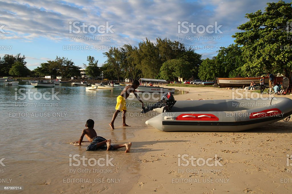 Beach at Grand Baie during Sunset, Mauritius, Africa stock photo
