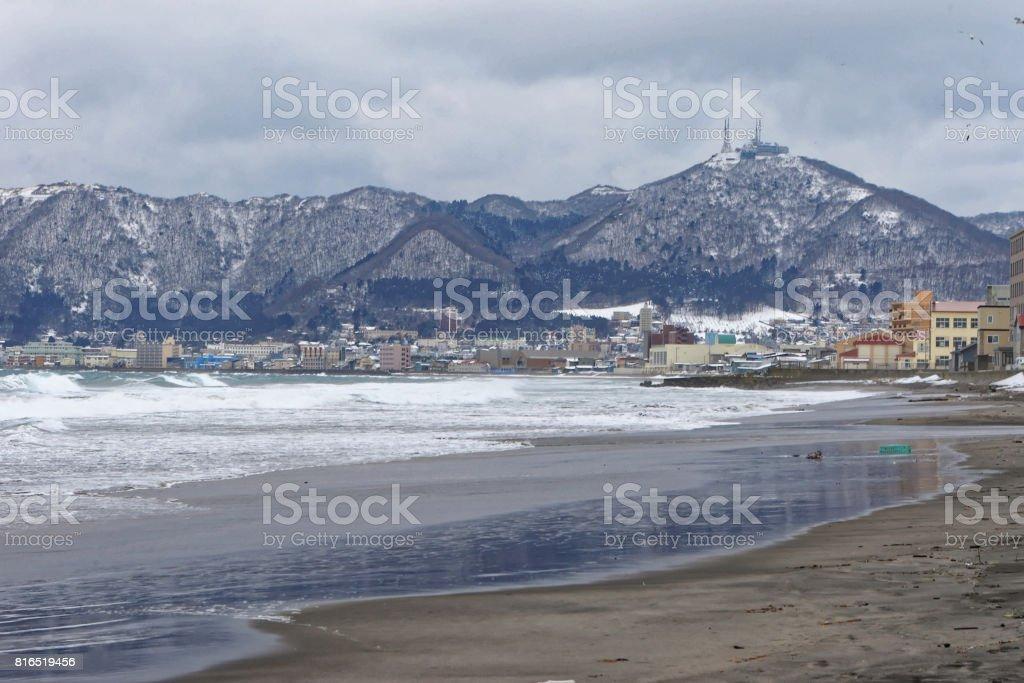 Beach at Hakodate in winter, viewing Mt. Hakodate stock photo