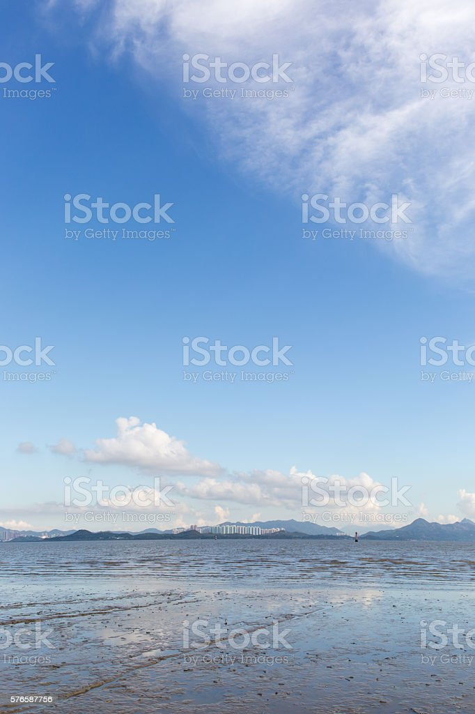 beach at low tide and sky stock photo