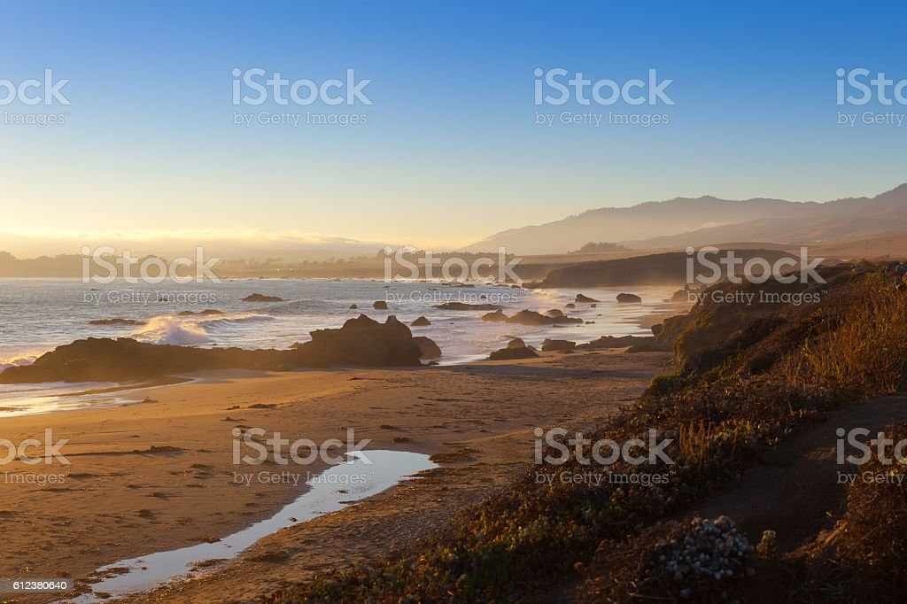 beach at sunset, San Simeon, California, United States of America stock photo