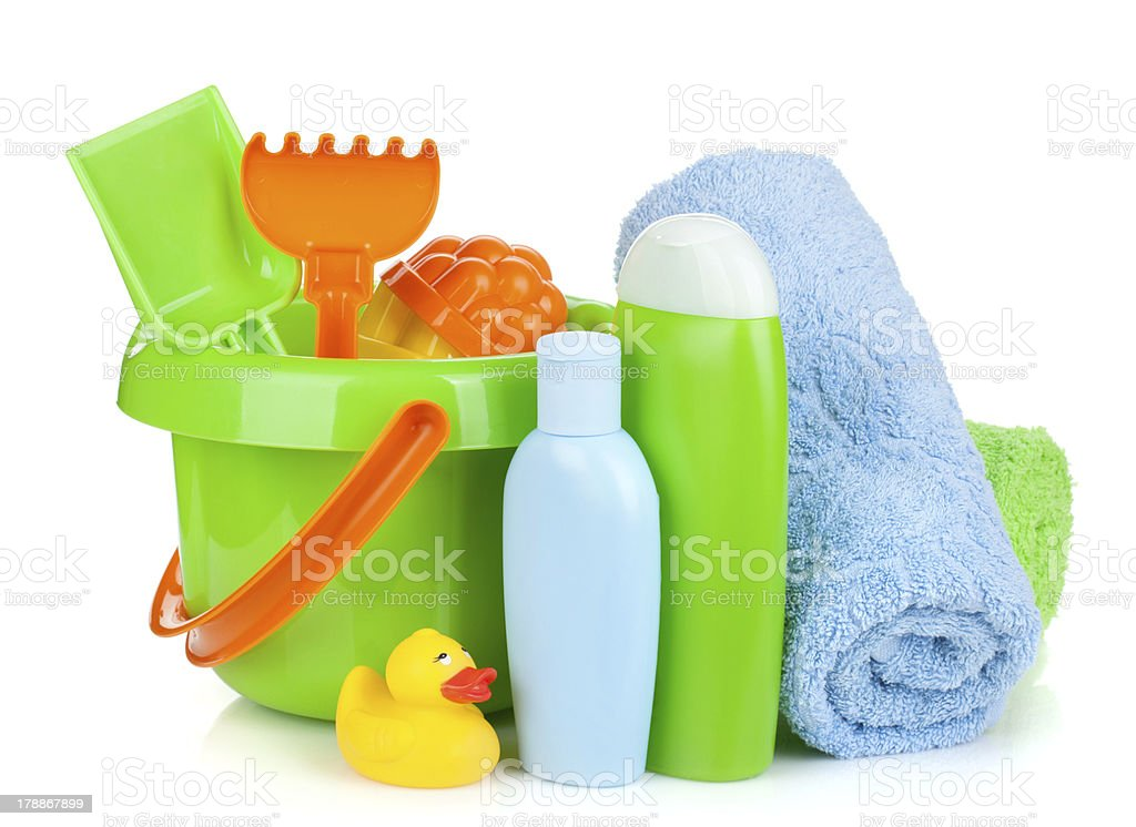 Beach baby toys, towels and bottles royalty-free stock photo