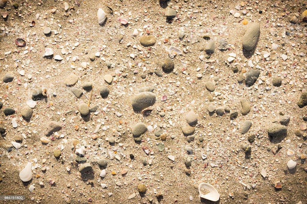 Beach background made of sand pebble and broken seashells stock photo