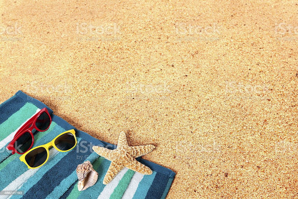 Beach background scene with sunglasses and starfish royalty-free stock photo