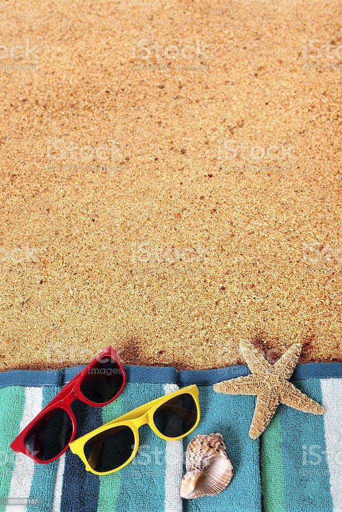 Beach background scene with sunglasses and starfish royalty-free stock photo
