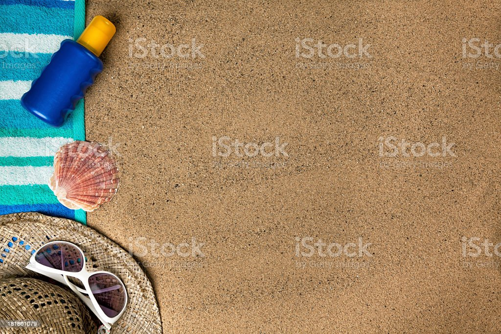 Beach background with sun hat, towel and sunscreen royalty-free stock photo