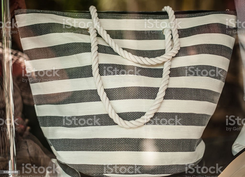 Beach bag in the fashion store stock photo