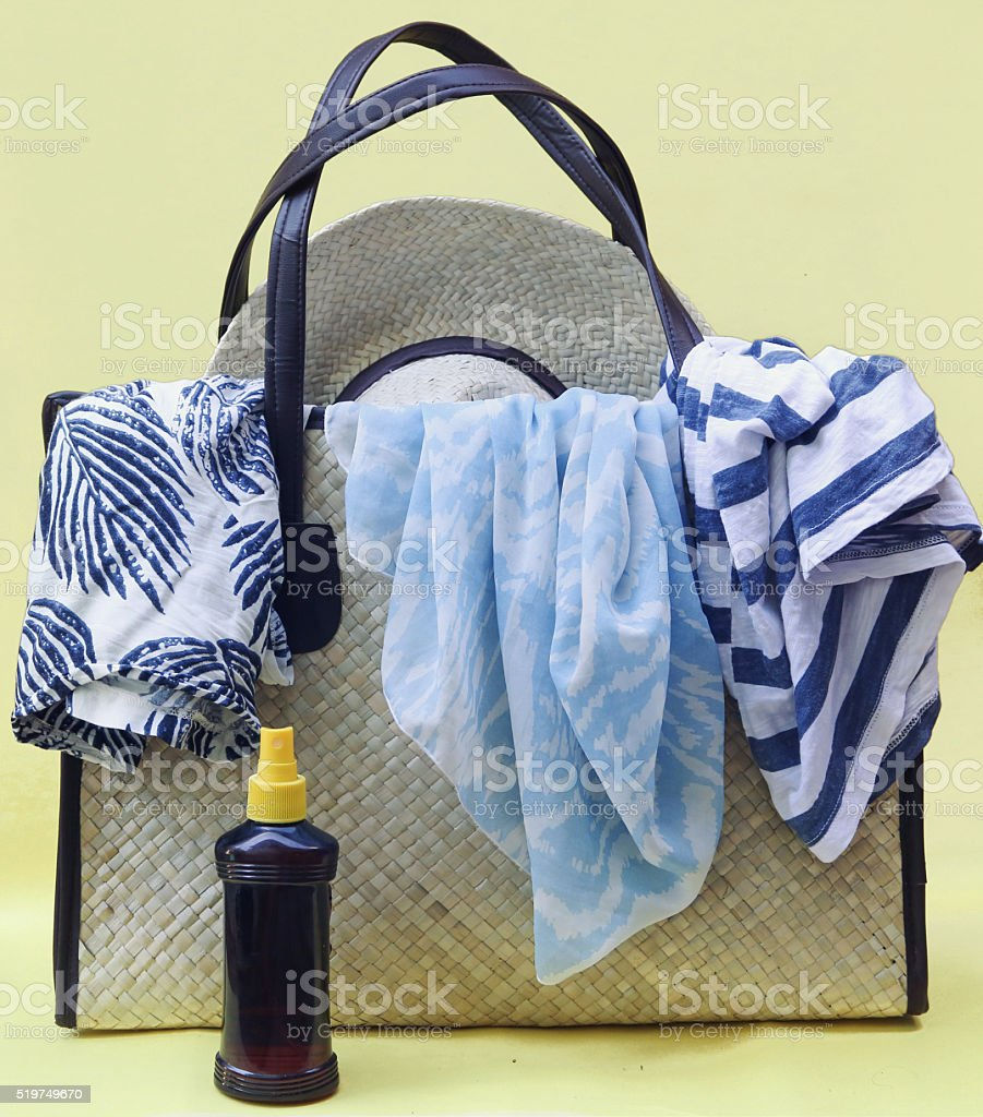 Beach bag on yellow background stock photo