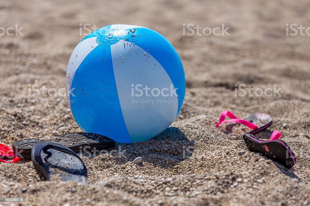 Beach ball and slippers stock photo